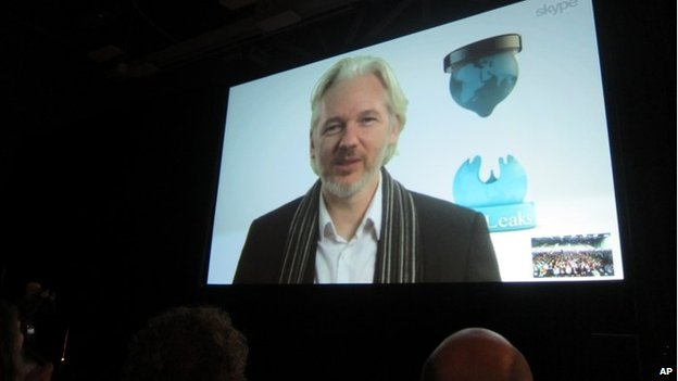 Fugitive Wikileaks founder Julian Assange speaks via Skype at the South By SouthWest Interactive festival in Austin, Texas, on 8 March 2014
