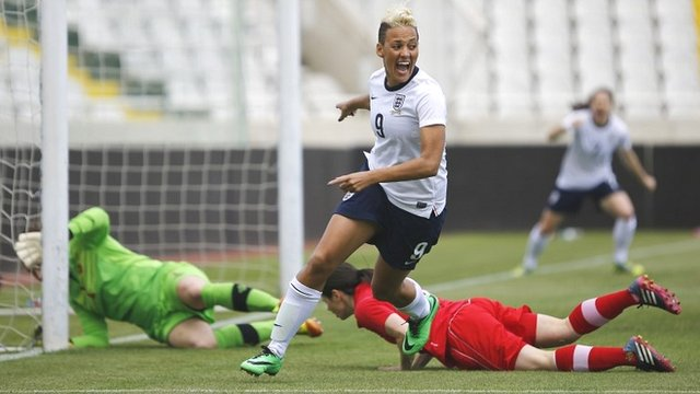 England's Lianne Sanderson celebrates after scoring against Canada