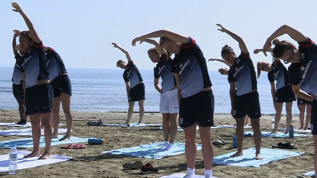 England women's football team do yoga on the beach in Cyprus