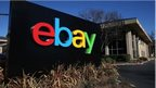 eBay cuts chief exec's pay in half