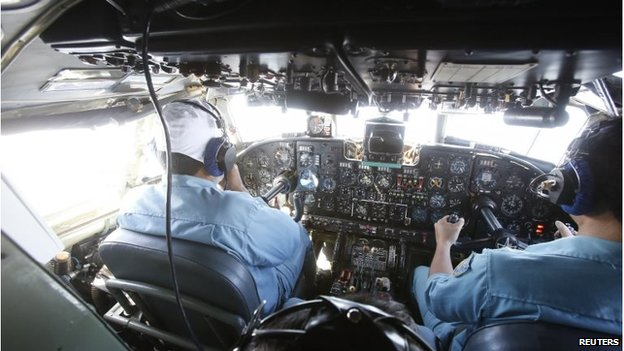 Military officers work within the cockpit of an aircraft AN-26 belonging to the Vietnam Air Force during a search and rescue mission off Vietnam's Tho Chu island March 10
