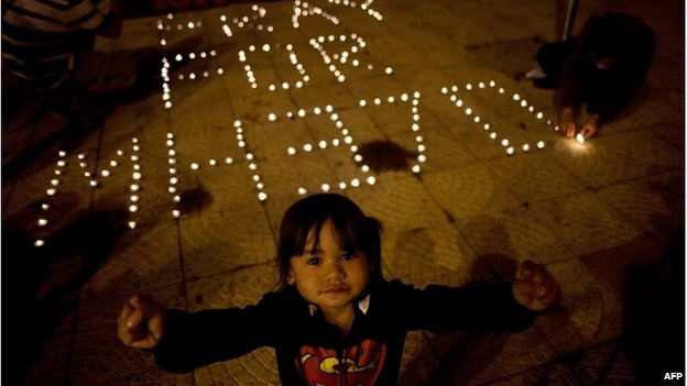 A Malaysian-Chinese child at a vigil for missing Malaysia Airlines passengers at the Independence Square in Kuala Lumpur on March 10