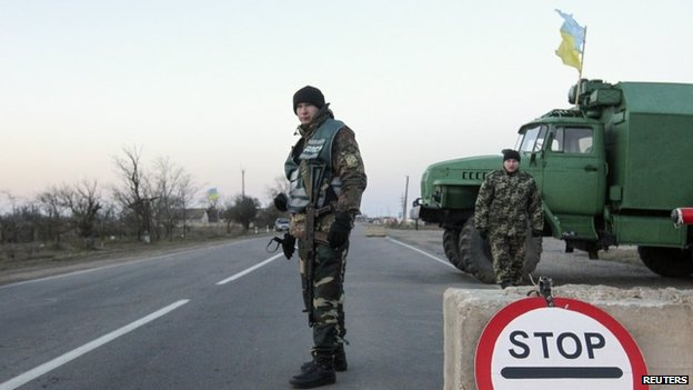 Ukrainian soldiers man a checkpoint near the village of Chongar, near the  Crimea region border
