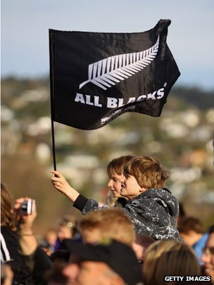 An All Black supporter waves a flag during a New Zealand All Blacks IRB Rugby World Cup 2011 fan day on 18 September 2011 in Christchurch, New Zealand
