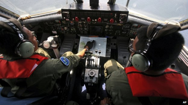 Indonesian Navy pilots during a search operation for the missing Malaysian Airlines Boeing 777 over the waters bordering Indonesia, Malaysia and Thailand near the Malacca straits on 10 March 2014