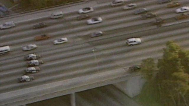 Police cars pursue OJ Simpson