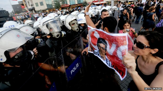 Protester holds picture of Berkin Elvan (July 2013)