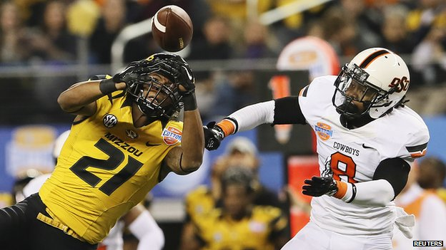 The 2014 Cotton Bowl game between the Oklahoma State Cowboy and the Missouri Tigers