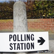 A polling station sign attached to a bollard (file photo)