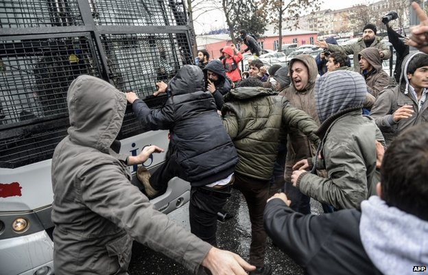 Protesters attacked a riot police vehicle outside the hospital where Berkin Elvan died