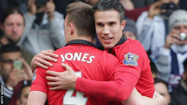 Manchester United duo Phil Jones and Robin van Persie celebrate