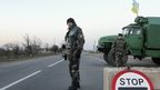 Ukrainian soldiers man a checkpoint near the village of Chungar, near the  Crimea region border