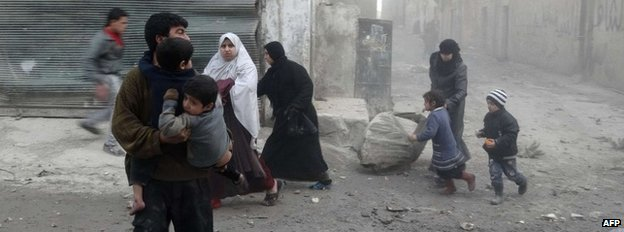Syrian civilians flee an air strike in Aleppo