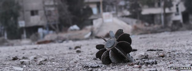 The remains of a mortar in a street of the Syrian city of Daraya, south west of the capital Damascus