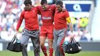 Wales' Rhys Webb leaves the field injured