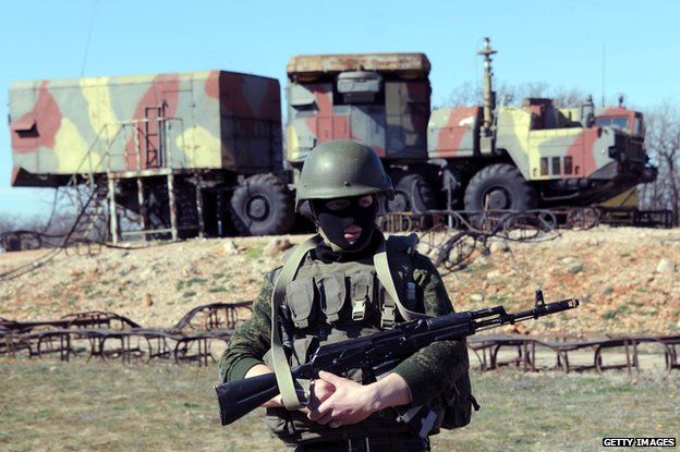 A member of the Russian forces guards in front of surface-to-air S300 missiles in a Ukrainian anti-aircraft missile unit on the Cape of Fiolent in Sevastopol on March 5, 2014