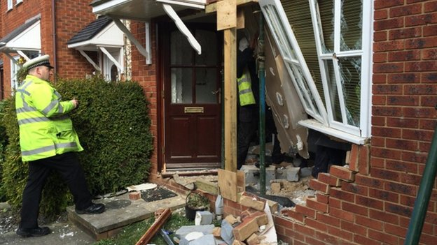 Damaged house after car collision