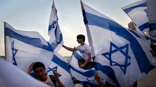 Israeli youths dance with Israeli flags