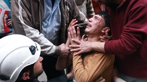 Grieving Syrian boy