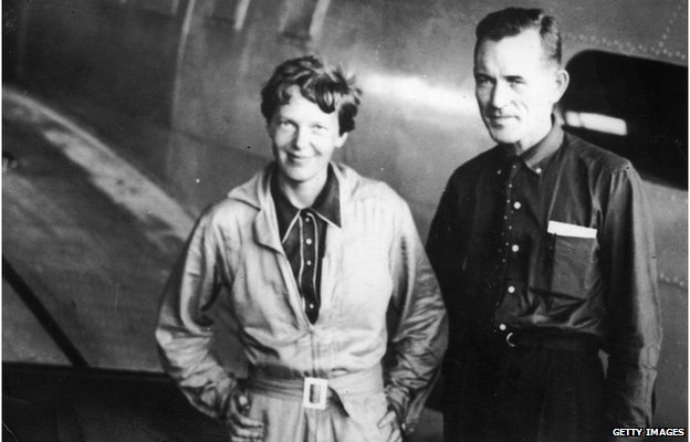 American pilot and pioneer Amelia Earhart, with her navigator Captain Fred Noonan, in the hangar at Parnamerim airfield, Natal, Brazil, 11th June 1937