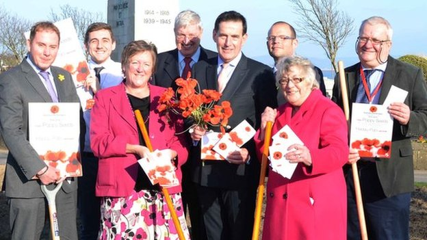 Members of Swansea council launching the poppy seed scheme