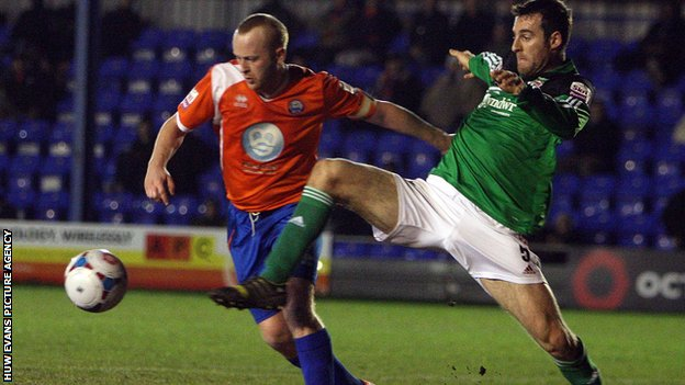 Danny Livesey of Wrexham battles with Braintree's Kenny Davis