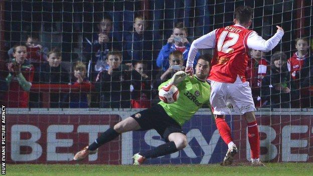 Jamie Devitt scores from the penalty spot against Newport County