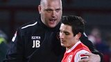 Morecambe manager Jim Bentley congratulates Jack Redshaw after his two goals helped secure a 4-1 win over Newport County