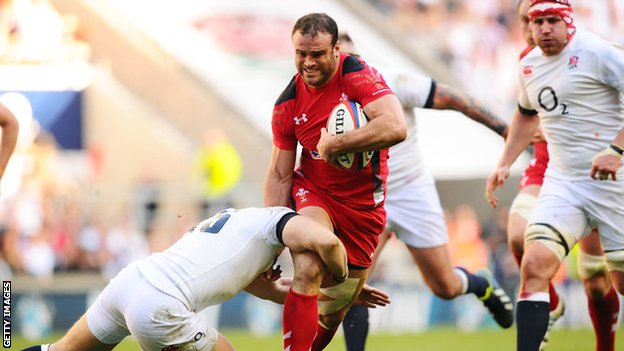 Jamie Roberts is tackled by