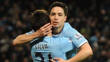Manchester City midfielders David Silva and Samir Nasri