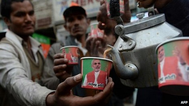 Paper cups bearing the portrait of Bharatiya Janata Party (BJP) prime ministerial candidate Narendra Modi are pictured as party workers distribute free tea at a roadside stall in New Delhi