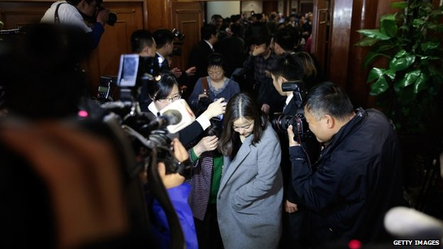 Chinese relatives of the passengers onboard flight MH370 walk out of a meeting room at Lido Hotel on 12 March  2014 in Beijing, China