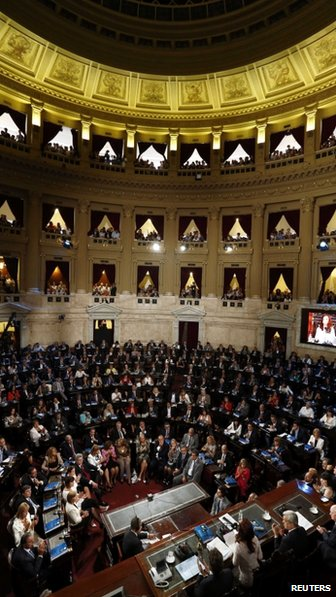 Cristina Fernandez de Kirchner speaks to lawmakers during the opening session of the 132nd legislative term of Congress in Buenos Aires