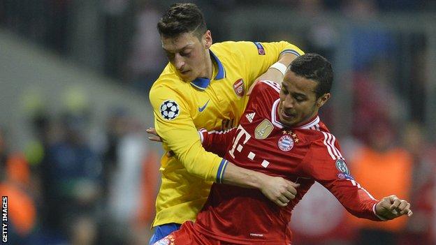 Bayern Munich's Spanish midfielder Thiago Alcantara and Arsenal's German midfielder Mesut Ozil