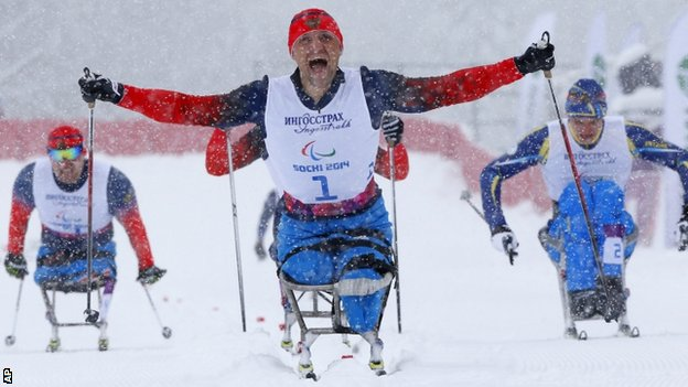 Roman Petushkov of Russia celebrates winning gold in men's cross country 1km sprint