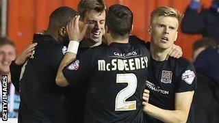 Northampton celebrate their winner on Tuesday