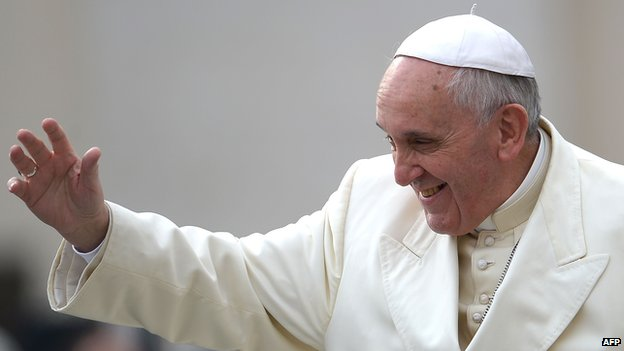 Pope Francis waves as he arrives for his general audience in St Peter's square at the Vatican on February 26, 2014
