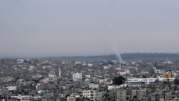 A trail of smoke from rockets fired from Gaza towards Israel was seen above Gaza City (12 March 2014)