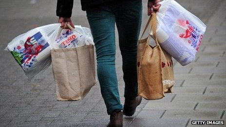 A man carrying Tesco shopping bags