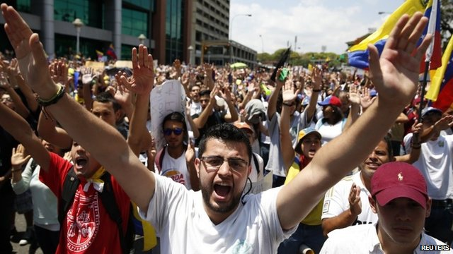 Anti-government protesters march during a demonstration in Caracas