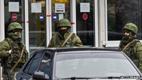 Armed men patrolled Simferopol's airport last month
