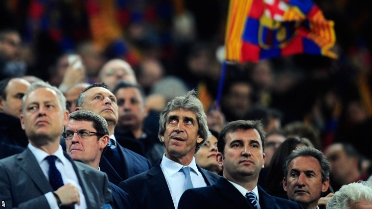 Man City boss Manuel Pellegrini watches his team from the stands