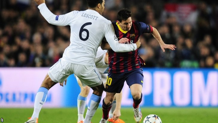 Joleon Lescott tries to tackle Lionel Messi