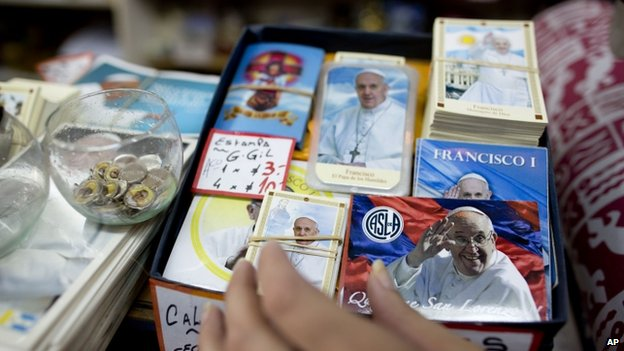 Artefacts with the image of Pope Francis are displayed at a shop in Buenos Aires, Argentina, (12 March 2014) a day ahead of the first anniversary of his election as pope