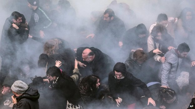Riot police use water cannons and teargas to disperse protesters in Istanbul (12 March 2014)
