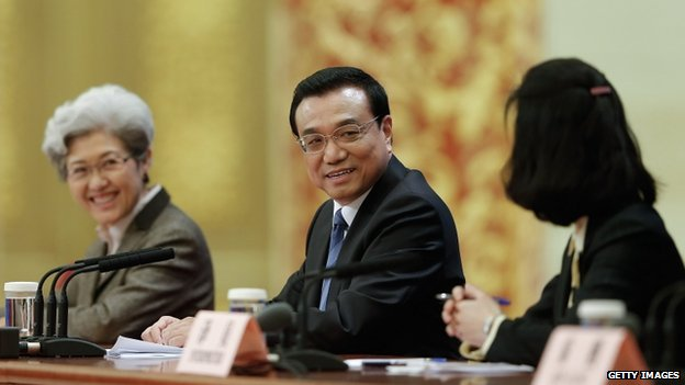 Chinese Premier Li Keqiang (C) attend a news conference after the closing session of the National People's Congress (NPC) at the Great Hall of the People on 13 March 2014 in Beijing, China