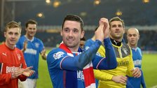Rangers players celebrate League One title victory