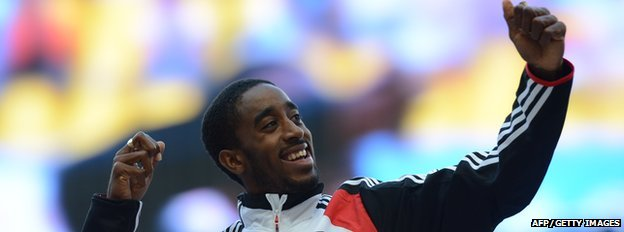 Jehue Gordon celebrates his 400m hurdle World Championship gold in 2013.