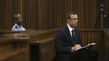 Olympic and Paralympic track star Oscar Pistorius sits in the dock during court proceedings at the North Gauteng High Court in Pretoria, March 13, 2014.