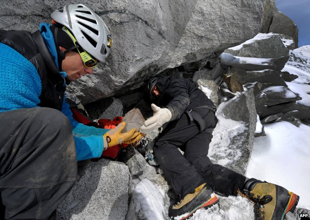 Stephane Dan and Alexandre Pittin find a piece of quartz in a cavity in La Dent du Geant, Mont Blanc